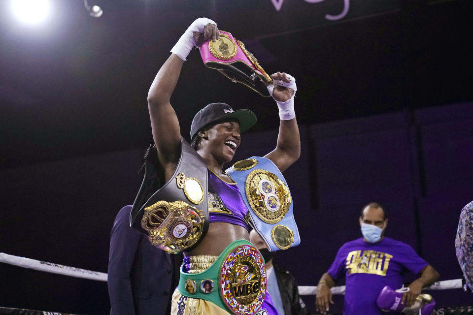 FILE - In this March 5, 2021, file photo, Claressa Shields holds her championship belts after defeating Marie-Eve Dicaire by decision for the women's super welterweight boxing title in Flint, Mich. Shields did it all in boxing. Two-time Olympic gold medalist. Professional titles in three weight classes. Now she'll try to conquer MMA, starting with her pro debut for Professional Fighters League on Thursday night, June 10, 2021, in Atlantic City, N.J. (AP Photo/Carlos Osorio, File)