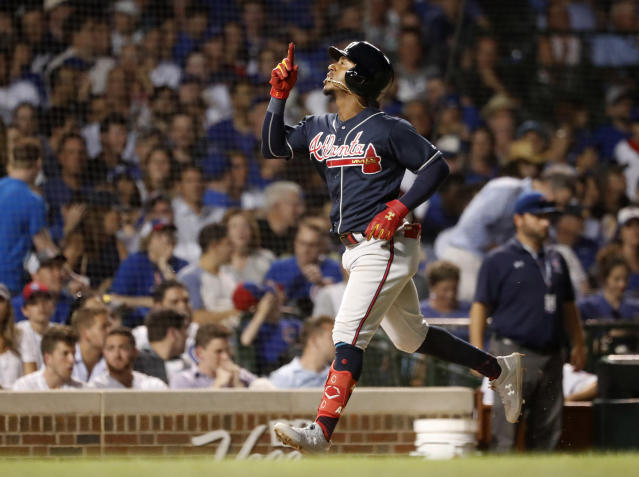 Atlanta Braves' Ozzie Albies celebrates his two-run home run off Chicago Cubs relief pitcher Mike Montgomery during the seventh inning of a baseball game, Tuesday, June 25, 2019, in Chicago. Brian McCann also scored on the play. (AP Photo/Charles Rex Arbogast)