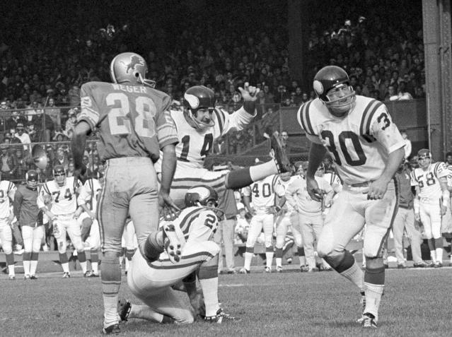 FILE - In this Sunday, Nov. 1, 1970 file photo, Minnesota Vikings Fred Cox (14) kicks a field goal from near the twenty-eight yard line on score three points in first quarter of an NFL football game against the Detroit Lions in Detroit. Fred Cox, the former Minnesota Vikings kicker who co-created the Nerf football, has died. He was 80. The Vikings announced Coxs death Thursday, Nov. 21, 2019. (AP Photo/File)
