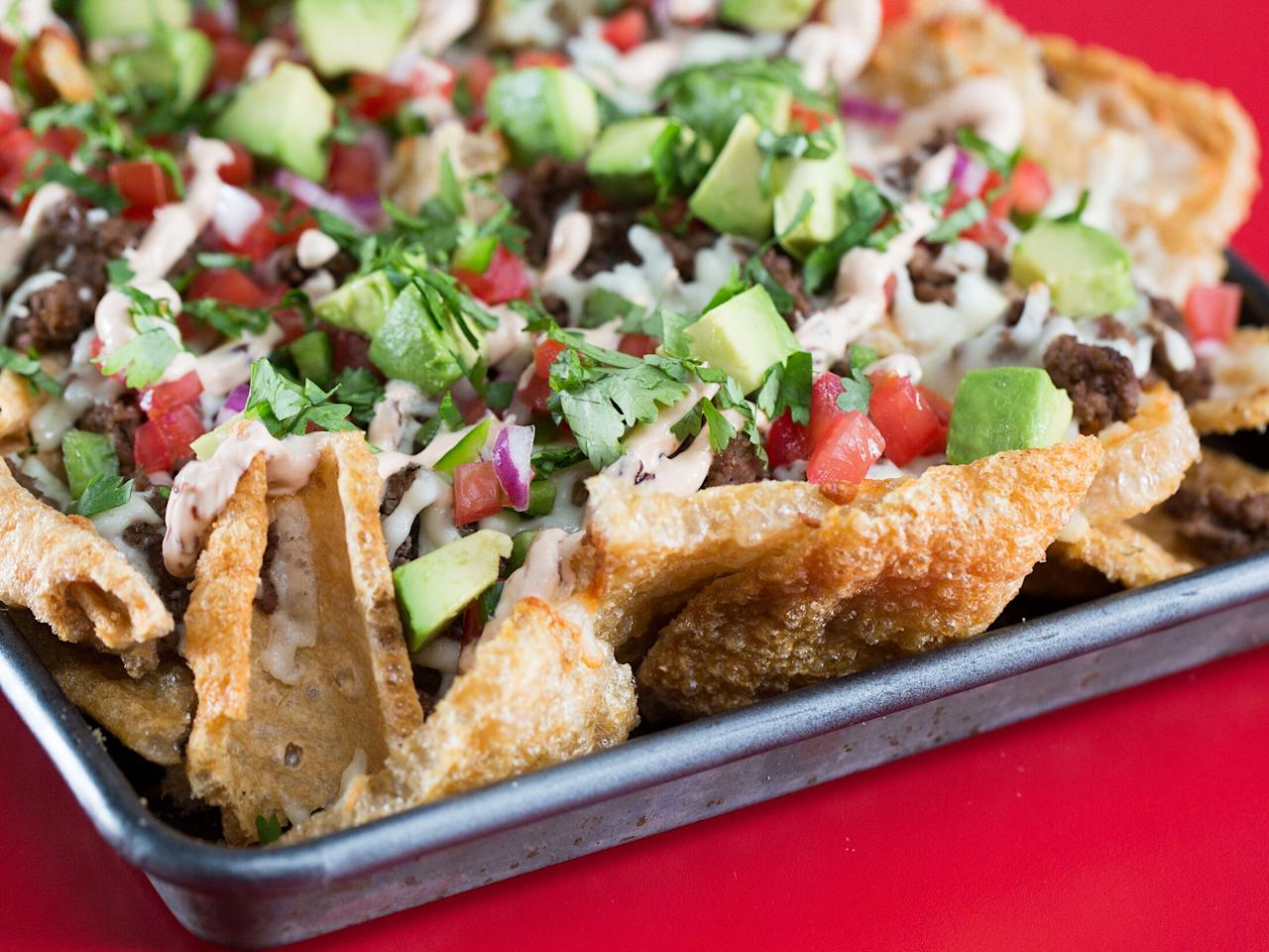 "We've got the perfect way to satisfy a high-carb craving without getting off your low-carb diet. These nachos are hearty and slightly chewy with a little bit of lightness. Balance the rich meat and cheese with creamy chipotle sauce and pico topping. Distribute the toppings evenly and work them into the spaces and crevices. This way, each ""chip"" gets toppings and the center doesn't end up a soggy mess.The best pork skins to use for this recipe are chicharrones, which are firmer and crispier. You can find them in large ""sheets"" at international markets or grocery stores. <a href=""https://www.myrecipes.com/recipe/keto-nachos"">Keto Nachos Recipe</a>"