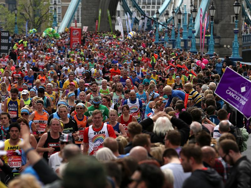 Runners make their way off Tower Bridge during the Virgin Money London Marathon, London: PA