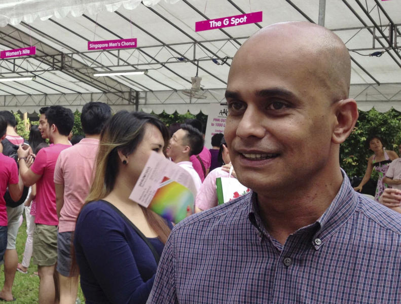 In this Saturday, June 29, 2013 photo, Singapore's first openly gay politician, Vincent Wijeysingha, a member of the opposition Singapore Democratic Party, speaks to reporters at the annual Pink Dot SG rally in support of gay rights in Singapore's Hong Lim Park. Wijeysingha recently confirmed that he is gay and said he believes Singapore's government will someday be forced to abolish a law that criminalizes consensual sex between men. (AP Photo/Satish Cheney)