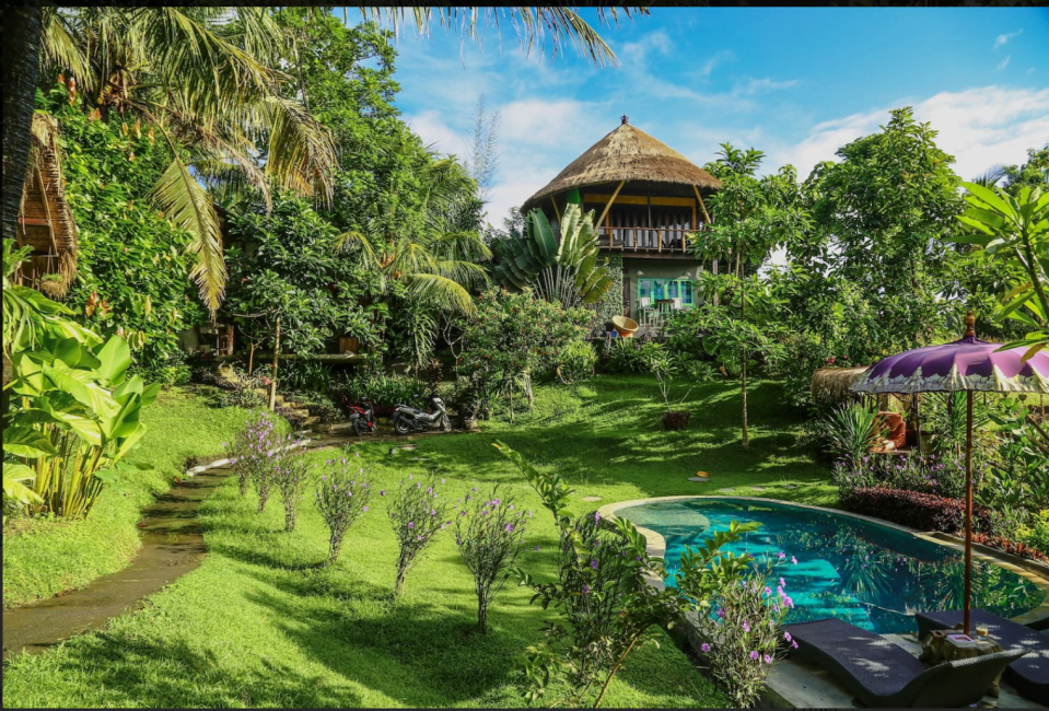 This Balinese treehouse in Denpasar features tropical gardens and a pool. Photo: supplied.