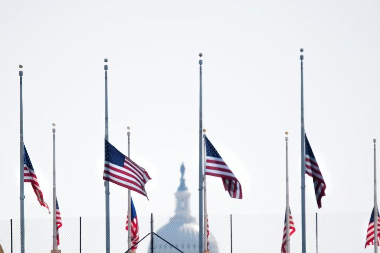 """American flags fly at half-staff in Washington, DC, on April 18, 2018, in honor of former First Lady Barbara Bush who passed away Tuesday night. Former US first lady Barbara Bush died Tuesday at the age of 92, triggering an outpouring of praise for the matriarch of a Republican family once at the apex of American politics. Barbara and George H.W. Bush were married for 73 years, and the widower """"of course is heart-broken to lose his beloved Barbara,"""" his chief of staff Jean Becker said in a statement"""