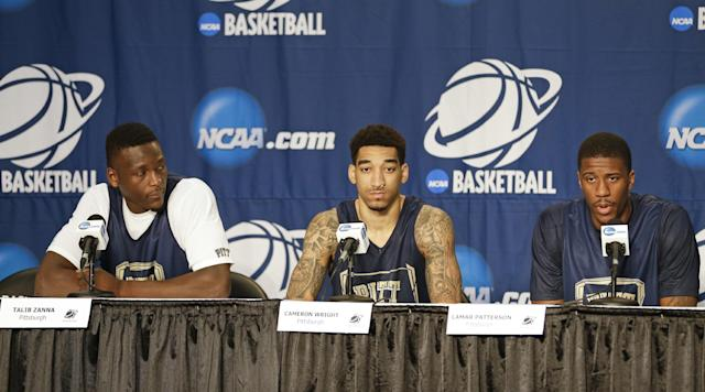 Pittsburgh players from left, Talib Zanna, Cameron Wright, and Lamar Patterson answer questions during a news conference for the NCAA college basketball tournament in Orlando, Fla., Wednesday, March 19, 2014. Colorado plays against Pittsburgh in a second round game on Thursday. (AP Photo/John Raoux)