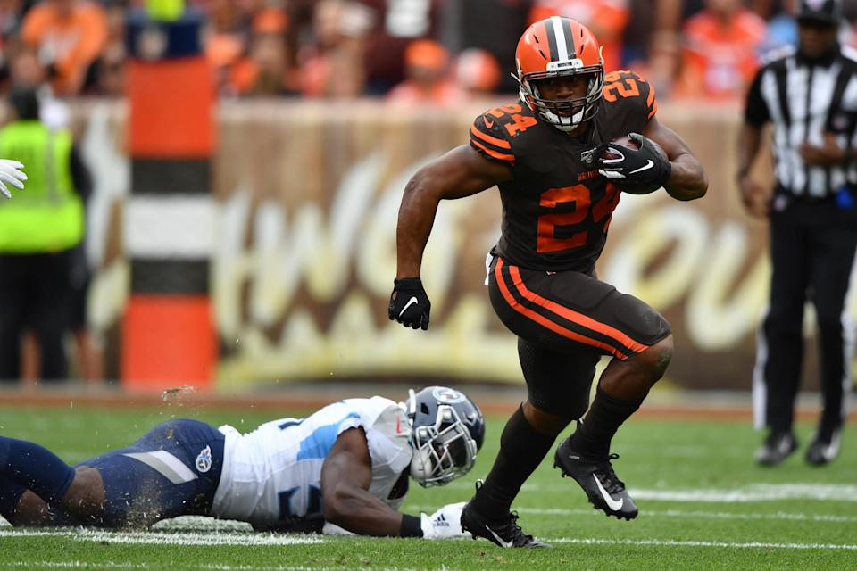 Nick Chubb #24 of the Cleveland Browns gets around the end for a gain in the second quarter against the Tennessee Titans at FirstEnergy Stadium on September 08, 2019 in Cleveland, Ohio . (Photo by Jamie Sabau/Getty Images)