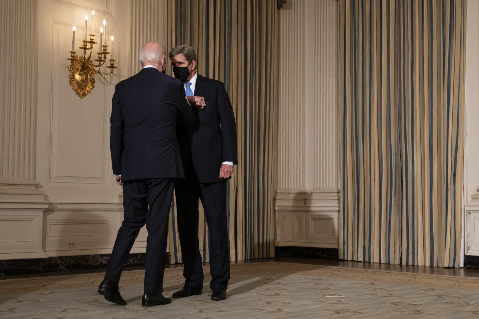 President Joe Biden greets Special Presidential Envoy for Climate John Kerry as he arrives to deliver remarks on climate change and green jobs, in the State Dining Room of the White House, Wednesday, Jan. 27, 2021, in Washington. (AP Photo/Evan Vucci)