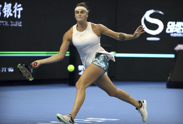 Aryna Sabalenka of Belarus hits a return shot while competing against Wang Qiang of China in their quarterfinal women's singles match in the China Open at the National Tennis Center in Beijing, Friday, Oct. 5, 2018. (AP Photo/Mark Schiefelbein)