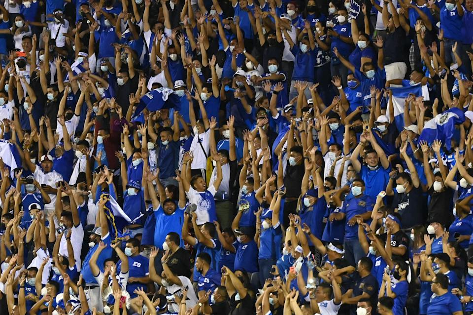 Fans of El Salvador cheer for their team during their Qatar 2020 FIFA World Cup Concacaf qualifier football match against Mexico at Cuscatlan Stadium, in San Salvador, on October 13, 2021. (Photo by MARVIN RECINOS / AFP) (Photo by MARVIN RECINOS/AFP via Getty Images)