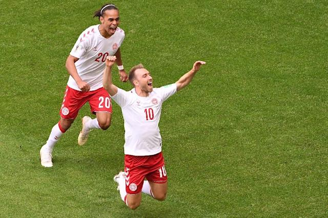 Denmark midfielder Christian Eriksen (right) celebrates his goal against Australia (AFP Photo/EMMANUEL DUNAND)