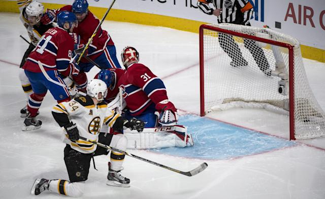 The puck goes inot the net past Montreal Canadiens goalie Carey Price on a goal by Boston Bruins' Matt Fraser during the first period overtime in Game 4 in the second round of the NHL Stanley Cup playoffs Thursday, May 8, 2014, in Montreal. (AP Photo/The Canadian Press, Paul Chiasson)