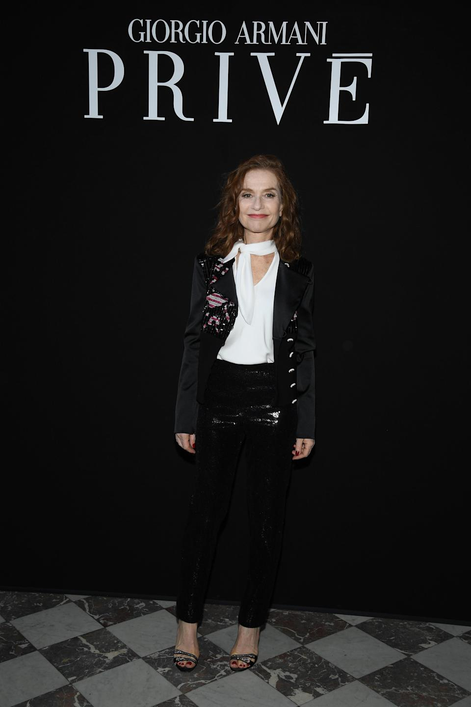 <p>On 3 July, Isabelle Huppert attended the Giorgio Armani Prive show in Paris wearing sequinned trousers and a military-inspired jacket. <em>[Photo: Getty]</em> </p>
