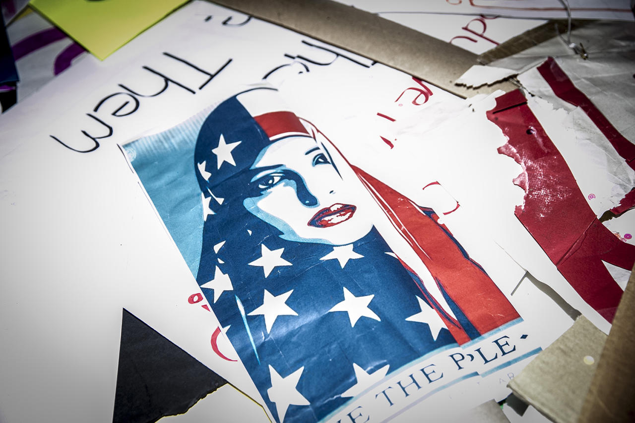 <p>Discarded signs from Women's March lie on the street around the corner from Trump Tower in New York City on Jan. 21, 2017. (Photo: Gordon Donovan/Yahoo News) </p>