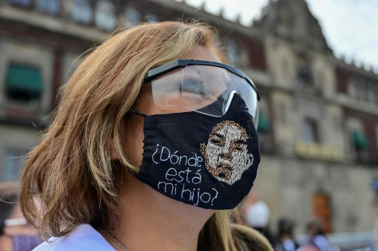 A woman wears a face mask reading 'Where is my son?' at a protest in Mexico City (AFP/PEDRO PARDO)