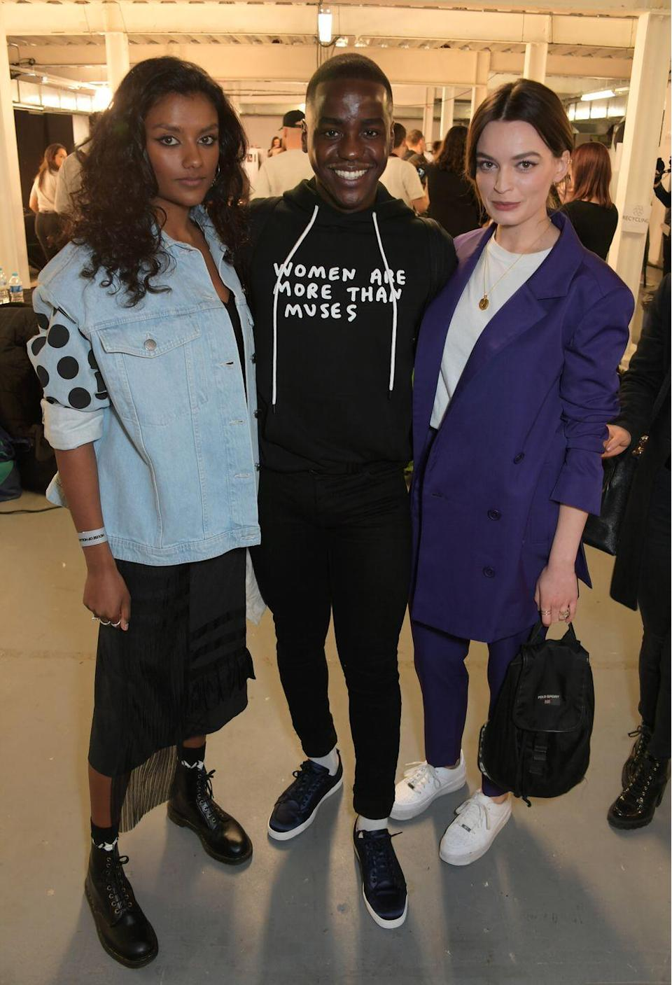 <p>This look was from London Fashion Week in 2019, but we are still very here for it. Big yes to the polka dot denim and classic boots + midi skirt combo.</p>