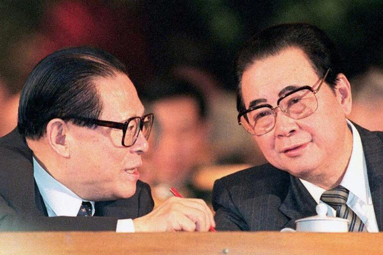 Li Peng (right), picured with then-president Jiang Zemin in 1997, gained notoriety worldwide as one of the key architects of the bloody crackdown on the Tiananmen pro-democracy protests (AFP Photo/Robyn BECK)