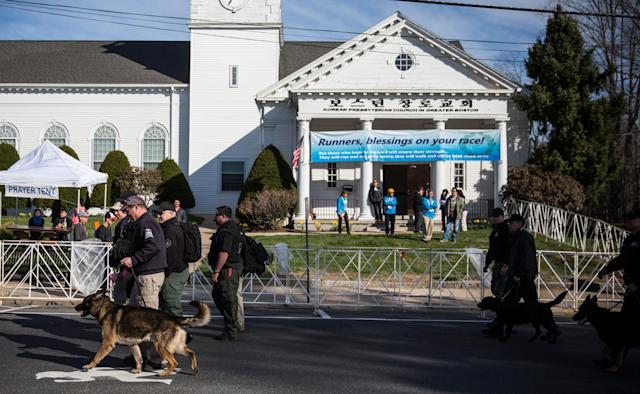 HOPKINGTON, MA - APRIL 21: Law enforcement officials patrol the start of the Boston Marathon with dogs on April 21, 2014 in Hopkington, Massachusetts. Today marks the 118th Boston Marathon; security presence has been increased this year, due to two bombs that were detonated at the finish line last year, killing three people and injuring more than 260 others. (Photo by Andrew Burton/Getty Images)