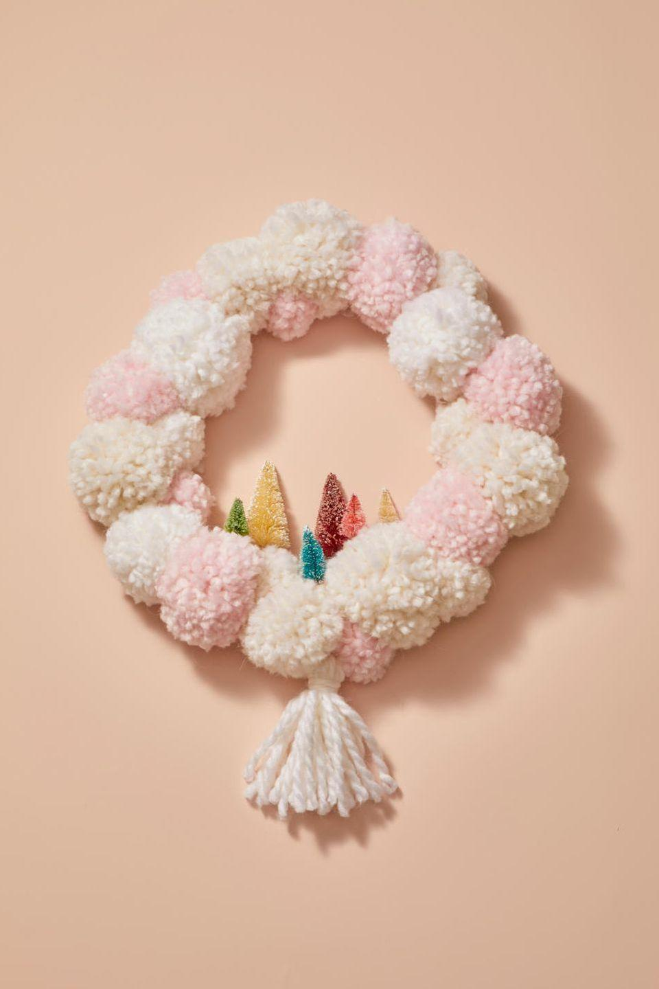 "<p>Once you have an assortment of pom-poms on hand, glue them directly onto a wreath form. Complement the look with a tassel and colorful bottle brush trees. </p><p><strong>RELATED:</strong> <a href=""https://www.goodhousekeeping.com/holidays/christmas-ideas/how-to/g1253/diy-christmas-wreaths/"" rel=""nofollow noopener"" target=""_blank"" data-ylk=""slk:60 Christmas Wreath Ideas for a Jolly Holiday"" class=""link rapid-noclick-resp"">60 Christmas Wreath Ideas for a Jolly Holiday</a></p>"