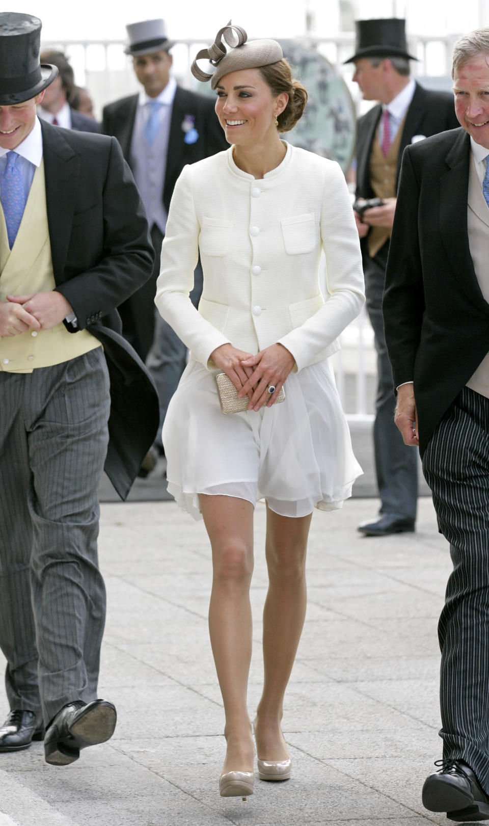 <p>Stick to what you know. Kate opted for a cream 'Peacock' dress by Reiss for a visit to the Epsom Downs in 2011. Again, the dress sold out within a matter of minutes… <em>[Photo: Getty]</em> </p>