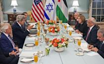 In this picture taken on July 29, 2013, then US Secretary of State John Kerry dines with Israeli Justice Minister Tzipi Livni and Palestinian chief negotiator Saeb Erekat at the US Department of State in Washington