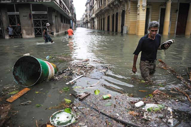 <p>Cubans wade through flooded streets in Havana, on Sept. 10, 2017. (Photo: Yamil Lage/AFP/Getty Images) </p>