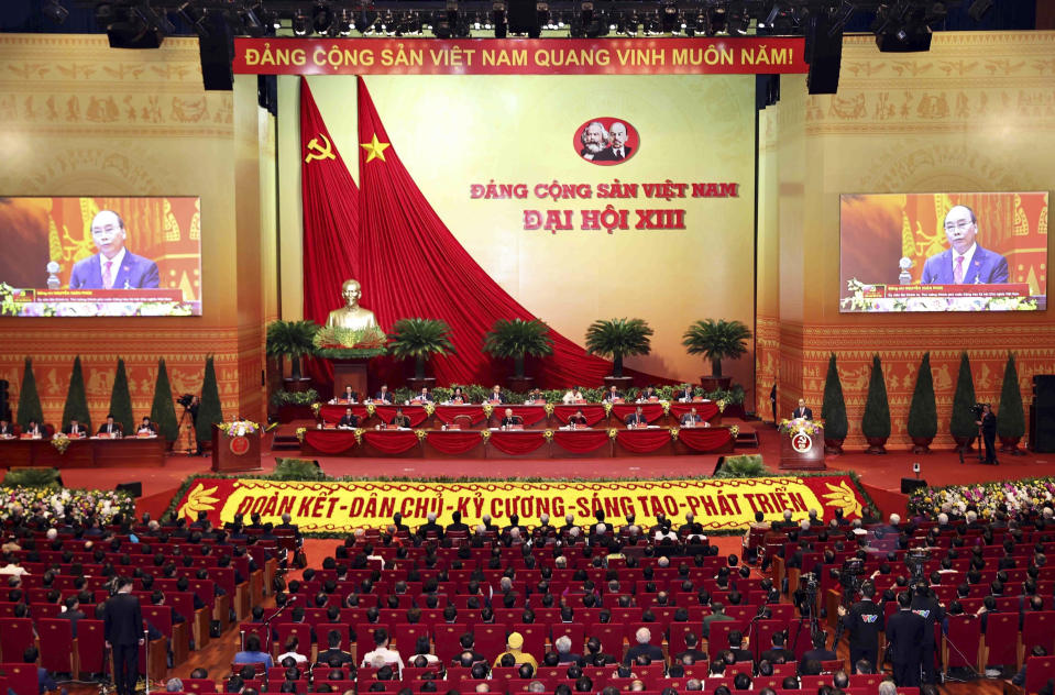 Delegates attend the opening of 13th Communist Party Congress in Hanoi, Vietnam on Tuesday, Jan. 26, 2021. Vietnam's ruling Communist Party has begun a crucial weeklong meeting in the capital Hanoi to set the nation's path for the next five years and appoint the country's top leaders. (An Van Dang/VNA via AP)