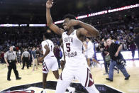 South Carolina guard Jermaine Couisnard (5) celebrates at the end of the team's NCAA college basketball game against Kentucky on Wednesday, Jan. 15, 2020, in Columbia, S.C. Couisnard hit the game-winning shot as South Carolina won 81-78. (AP Photo/Sean Rayford)
