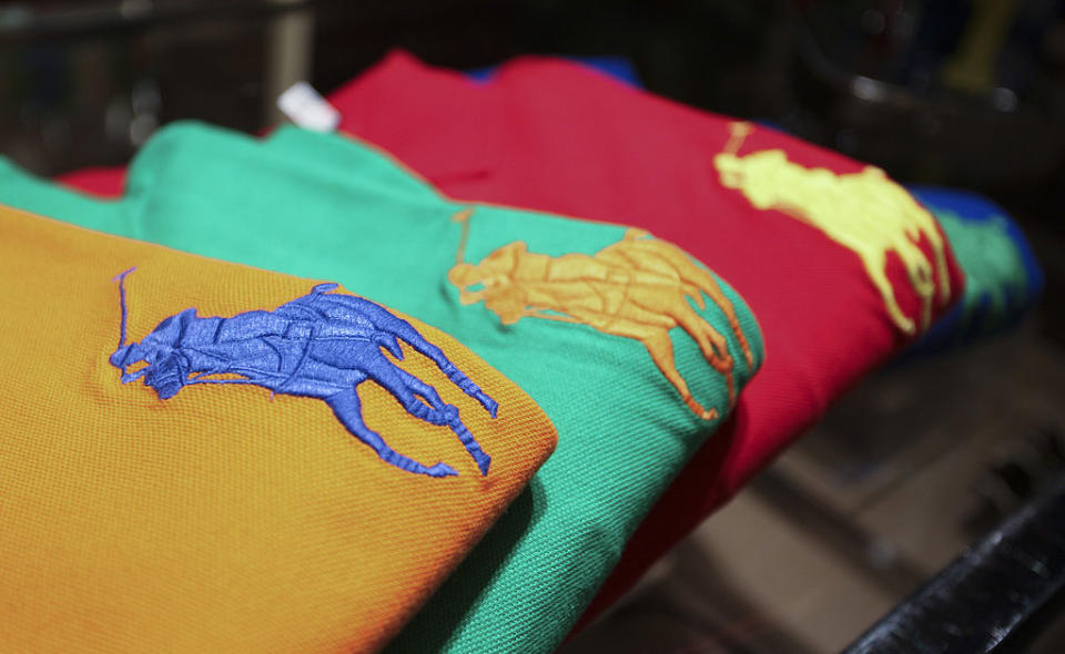 Polo shirts sit on display at the Ralph Lauren store in London, U.K., on Thursday, Nov. 11, 2010