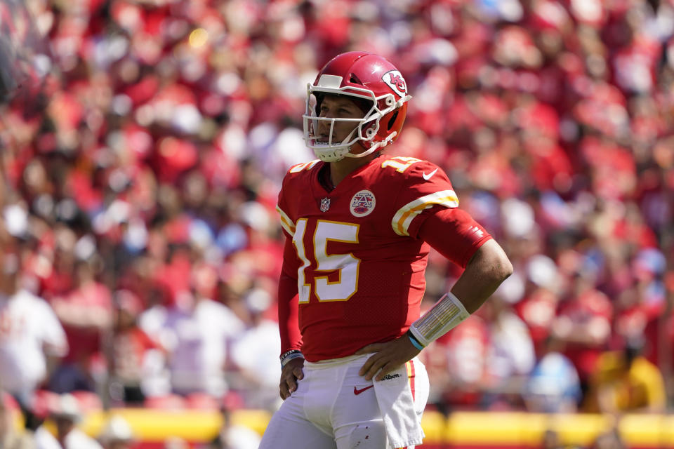 Kansas City Chiefs quarterback Patrick Mahomes (15) watches during the first half of an NFL football game against the Los Angeles Chargers, Sunday, Sept. 26, 2021, in Kansas City, Mo. (AP Photo/Ed Zurga)
