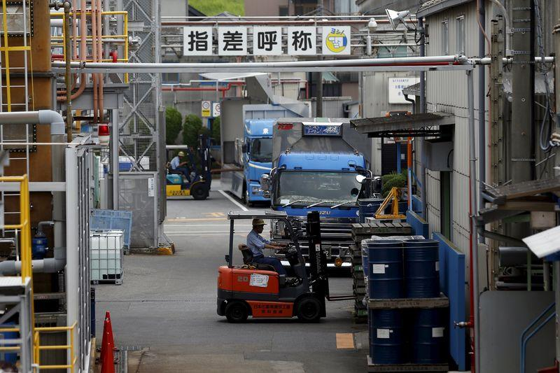 Workers are seen at Nippon Kayaku Co's factory in Tokyo