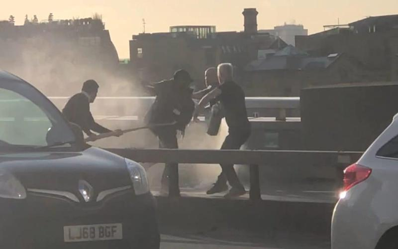 Two men can be seen cornering the terrorist on London Bridge armed only with the nearest objects which came to hand