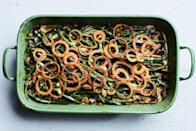 """A mix of wild mushrooms lends an earthy touch to this creamy classic. The spiced fried onions really turn this into an impressive Thanksgiving side. <a href=""""https://www.epicurious.com/recipes/food/views/green-bean-and-mushroom-casserole-with-crispy-fried-onions?mbid=synd_yahoo_rss"""" rel=""""nofollow noopener"""" target=""""_blank"""" data-ylk=""""slk:See recipe."""" class=""""link rapid-noclick-resp"""">See recipe.</a>"""