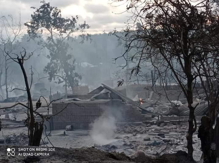 A view shows burnt houses in Kin Ma Village