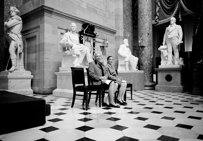 "March 2001 The only two female Justices of the U.S. Supreme Court, Sandra Day O'Connor and Ruth Bader Ginsburg, pose for a portrait in Statuary Hall, surrounded by statues of men at the U.S. Capitol Building in Washington, D.C. The two Justices were preparing to address a meeting of the Congressional Women's Caucus. <span class=""copyright"">David Hume Kennerly—Getty Images</span>"