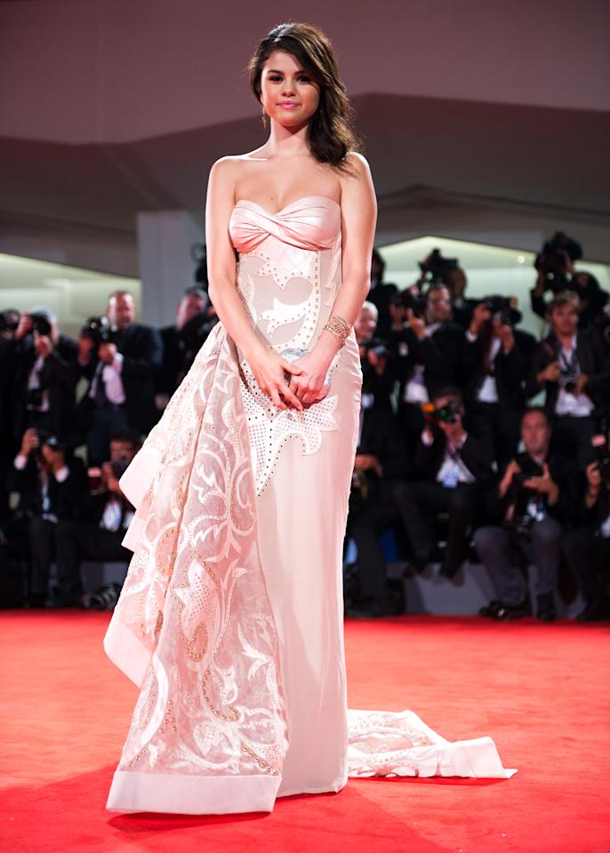 "Selena Gomez looked grown-up and gorgeous at the 69th Annual Venice Film Festival premiere of ""Spring Breakers"" on September 5, 2012. The 20-year-old former Disney star wore a stunning strapless Versace Atelier gown and Sergio Rossi heels. A Judith Leiber clutch and Lorraine Schwartz jewelry completed the look. She admitted that the movie, about a wild spring break, would shock her fans. ""People do put a label on you. I know that I have younger fans, and this is an opportunity for myself to kind of grow. It is a little shocking, I think, for the younger audiences. ... but I think it was right for me."""