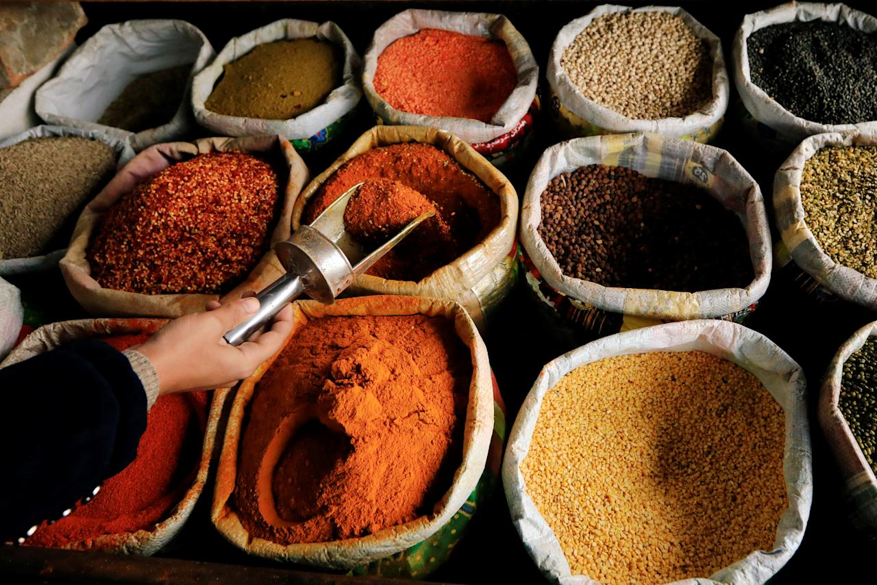 A man displays spices at a wholesale market in Islamabad, Pakistan December 11, 2018.  PREUTERS/Faisal Mahmood