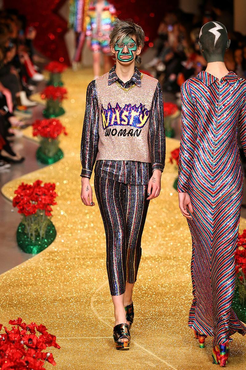 """<p>Ashish's political references become more explicit throughout his collection. The phrase """"nasty woman,"""" a direct reference to Trump's comments on Hillary Clinton during a presidential debate, made an appearance on the runway. (Photo: Getty Images) </p>"""