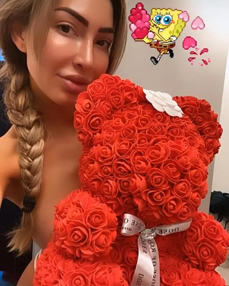 Farrah Abraham poses topless with a teddy bear made of roses