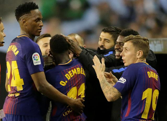 Soccer Football - La Liga Santander - Celta Vigo vs FC Barcelona - Balaidos, Vigo, Spain - April 17, 2018 Barcelona's Ousmane Dembele celebrates scoring their first goal with Yerry Mina and team mates REUTERS/Miguel Vidal