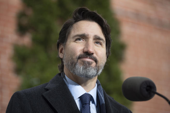 Canadian Prime Minister Justin Trudeau listens to a question from a reporter during a bi-weekly news conference outside Rideau cottage in Ottawa, Ontario, Friday, Nov. 27, 2020. (Adrian Wyld/The Canadian Press via AP)
