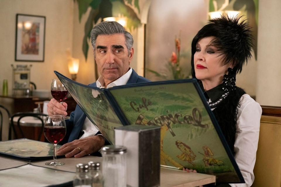 """<p><em>Pop TV</em> <a class=""""link rapid-noclick-resp"""" href=""""https://www.poptv.com/schittscreek"""" rel=""""nofollow noopener"""" target=""""_blank"""" data-ylk=""""slk:Watch Now"""">Watch Now</a></p><p>Over five seasons, this low-stakes comedy has grown with its characters. At the start, it was a simple fish-out-of-water gag, and an excuse to poke fun at rich people (not that we needed another one). These days, it's equal parts heartwarming and hilarious, as the show follows David and Alexis into their belated adulthood. But even with great scripts, <em>Schitt's Creek</em> wouldn't work without impeccable comedic timing of the core four: Eugene Levy, Dan Levy, Catherine O'Hara, and Annie Murphy.</p>"""