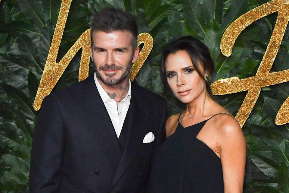 The Beckhams have been criticised for sharing an image of David Beckham kissing daughter Harper on the lips, pictured in December 2018. (Getty Images)