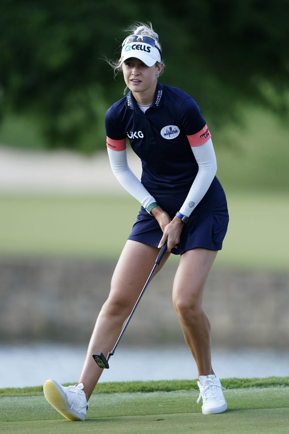 Nelly Korda react after making a putt for birdie on the eighth hole during the second round of play in the KPMG Women's PGA Championship golf tournament Friday, June 25, 2021, in Johns Creek, Ga. (AP Photo/John Bazemore)