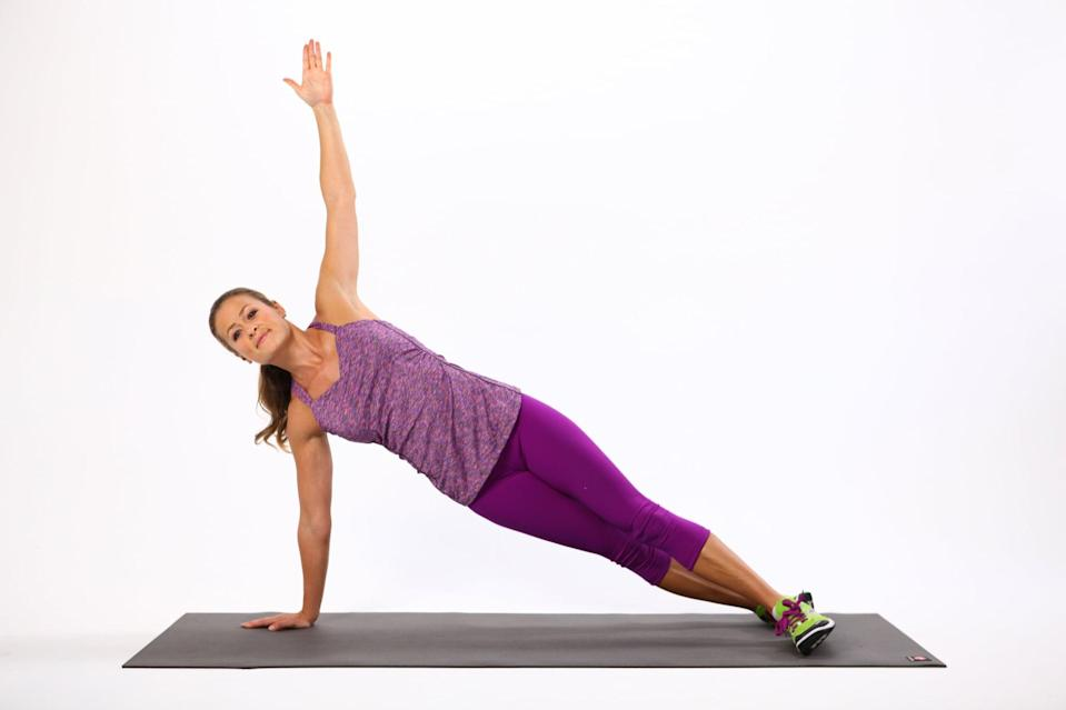 <ul> <li>Sit on your right side with your legs slightly bent and your feet stacked.</li> <li>Place your right hand about 12 inches from your pelvis.</li> <li>Push your hand into the ground, and straighten your legs as you lift your pelvis off the ground. If you have trouble balancing, stagger your feet so the top leg is in front.</li> <li>Hold for 30 seconds, and switch sides to complete one rep.</li> </ul>