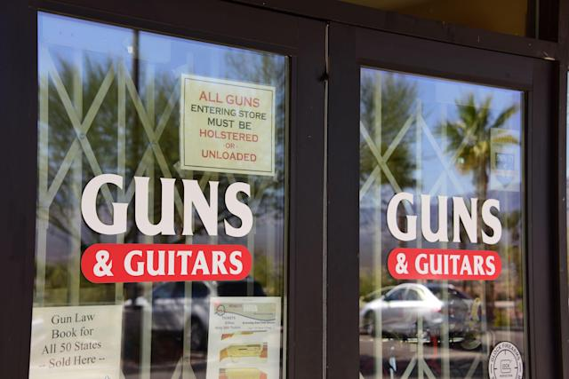 <p>The entrance to Guns & Guitars store is seen in Mesquite, Nev., Oct. 3, 2017. Stephen Paddock, who had purchased fire arms at Guns & Guitars, killed dozens and injured hundreds when he opened fire on a country music concert in Las Vegas, Nevada, Oct. 1, 2017. (Photo: Robyn Beck/AFP/Getty Images) </p>