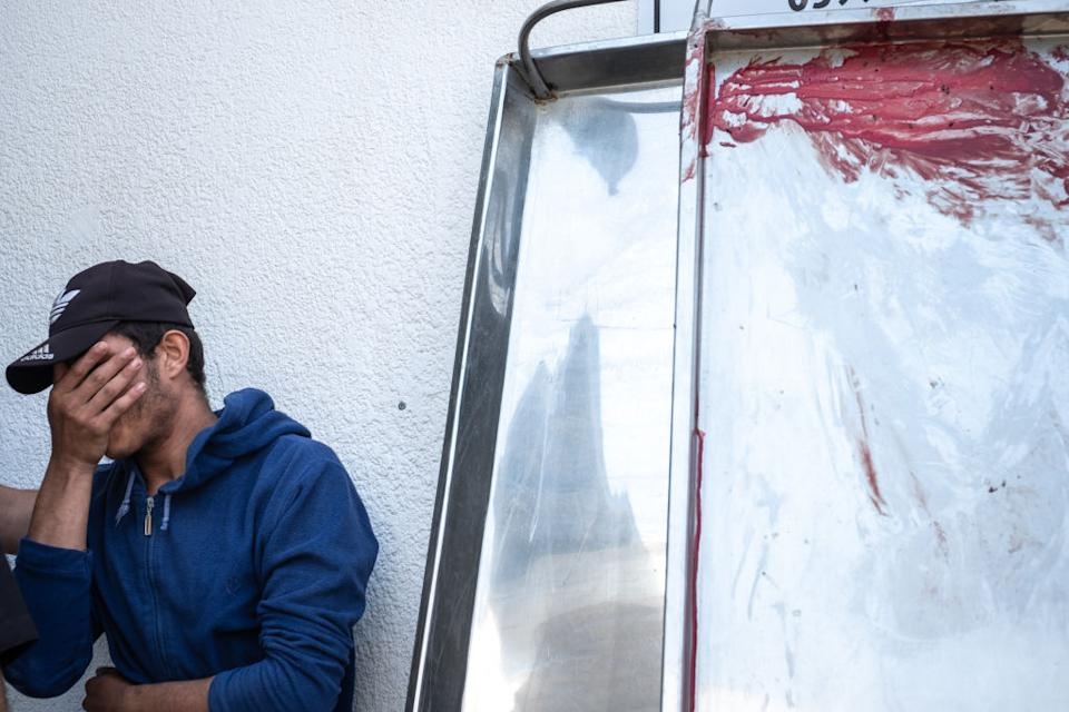 Palestinian Ibrahim Hasanin's blood smeared on a metal surface after he was killed during an Israeli raid on Beit Hanoun City.