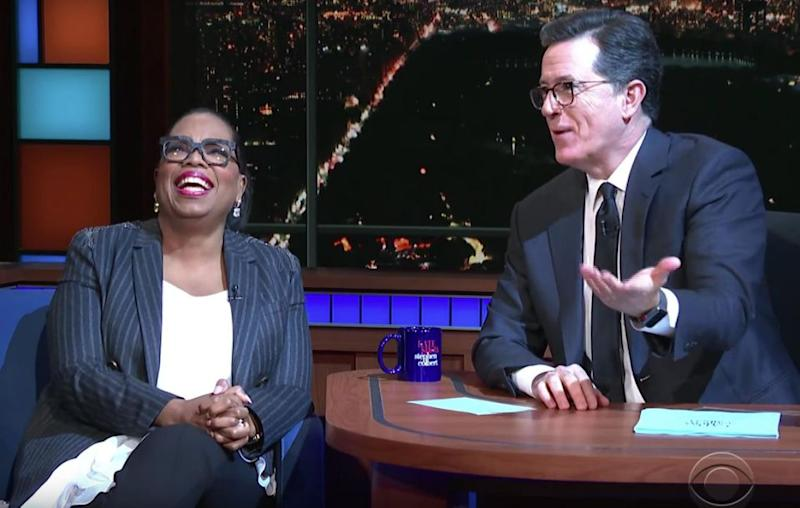 Oprah, clearly taken aback, couldn't contain her laughter at God's sudden arrival. Source: YouTube / The Late Show with Stephen Colbert