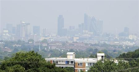 Buildings in the financial district are obscured in a haze, as seen from Crystal Palace in south London