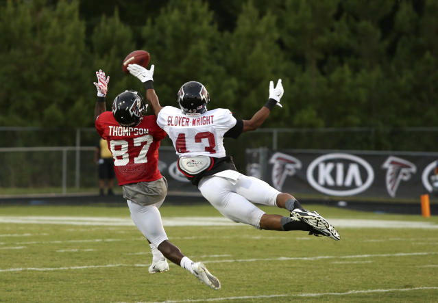 Atlanta Falcons defensive back Tay Glover-Wright, right, breaks up a pass intended for wide receiver Tramaine Thompson (87) during Friday Night Lights, at Archer High School Friday, Aug. 1, 2014, in Lawrenceville, Ga. The Falcons continued their tradition of staging NFL football practice at an area high school each year.(AP Photo/Jason Getz)