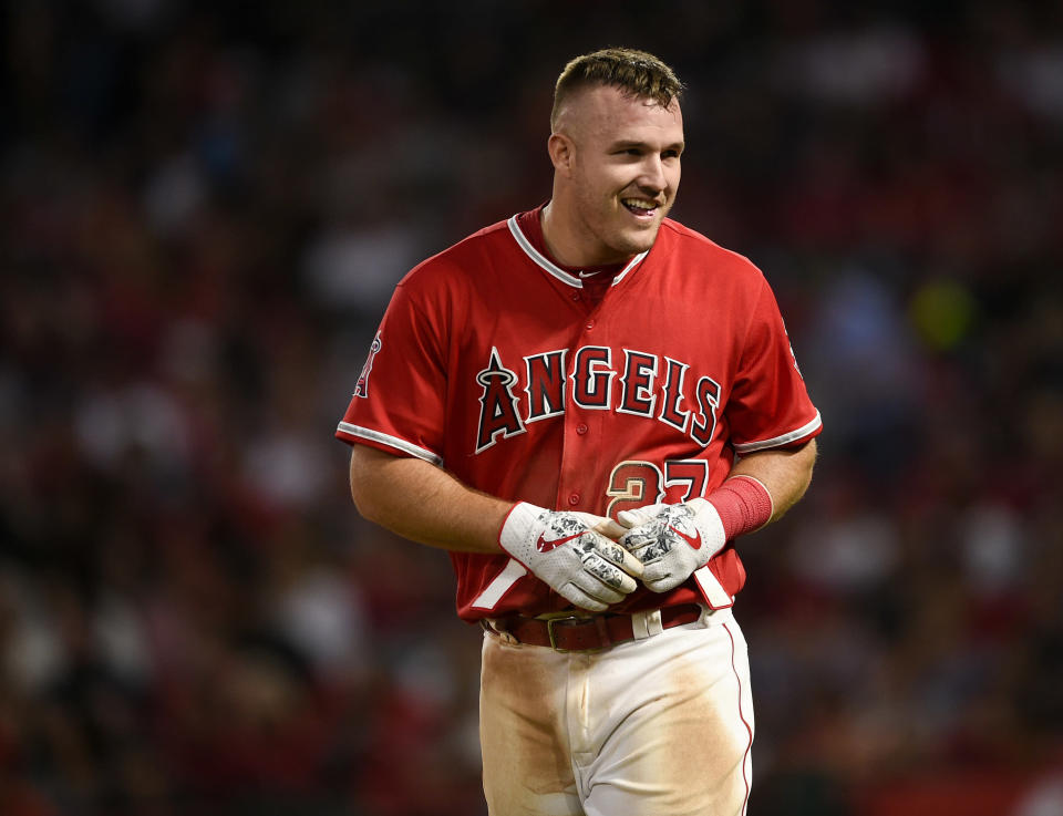 FILE - In this June 2, 2018, file photo, Los Angeles Angels center fielder Mike Trout smiles during the sixth inning of the team's baseball game against the Texas Rangers in Anaheim, Calif. Trout, Albert Pujols, Justin Upton, Andrelton Simmons and Shohei Ohtani are all familiar with new manager Brad Ausmus, and theyre not alone. The Angels didnt change the major components of last years 80-win team, instead banking on improved health and new leadership to propel them closer to their first playoff victory in Trouts career. (AP Photo/Kelvin Kuo, File)